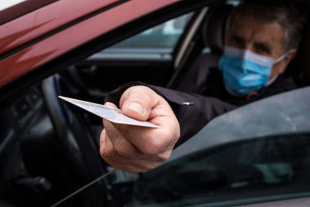 Italy Border Control due to Coronavirus Senior man traveling with Facemask, Slovenia on Italian border. geographical border stock pictures, royalty-free photos & images