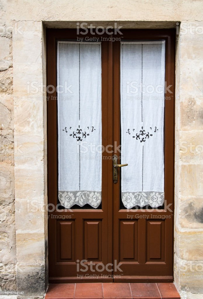 Italy Brown Wood French Doors With Lace Curtains Stock Photo Download Image Now Istock