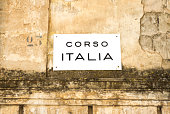 Italy: 'Corso ITALIA' Street Sign on Old Yellow Wall