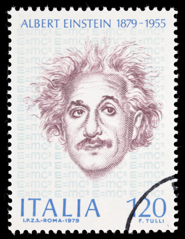 Sacramento, California, USA - March 19, 2011: A 1979 Italy postage stamp with a portrait of Albert Einstein (1879-1955), and E=mc2 repeated in the background. Issued to celebrate the 100th anniversary of Einstein's birth. Stamp design by F. Tulli.