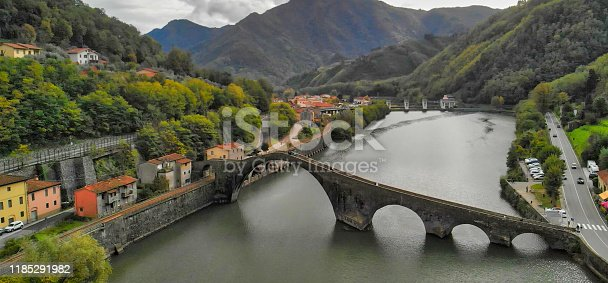 Italy, Europe. Tuscany. Aerial  view of Devils Bridge - Ponte della Maddalena is a bridge crossing the Serchio river near the town of Lucca, Tuscany