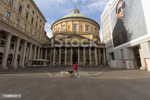 A person walk in front of Cathedral of San Carlo al Corso, Milan, Italy