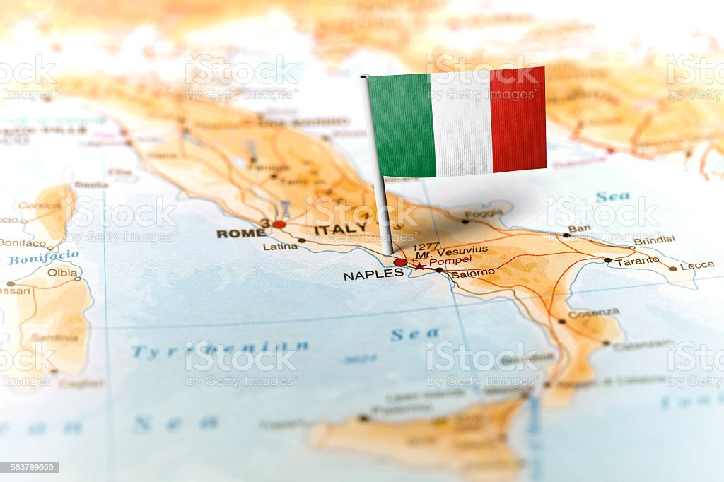 Italy pinned on the map with flag stock photo