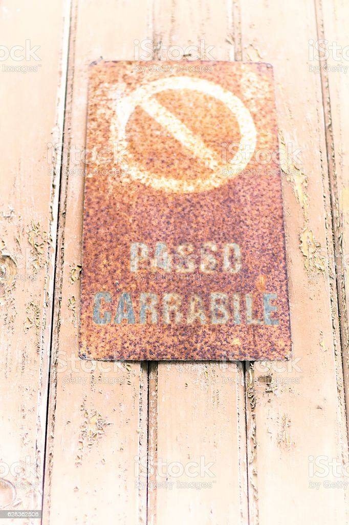 Italy Road Sign/Symbol: Rusty Vintage 'Passo Carrabile' (Tow-Away Zone) stock photo