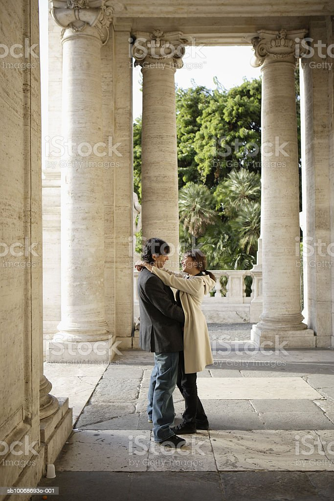 Italy, Rome, couple embracing 免版稅 stock photo