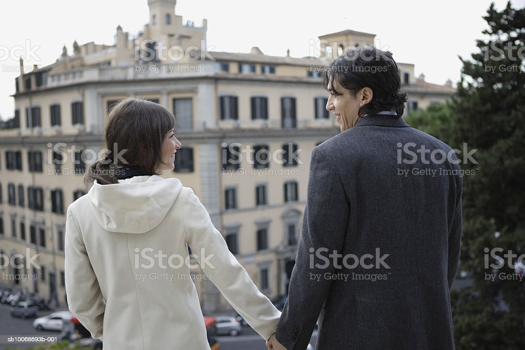 Italy, Rome, couple holding hands, rear view foto royalty-free