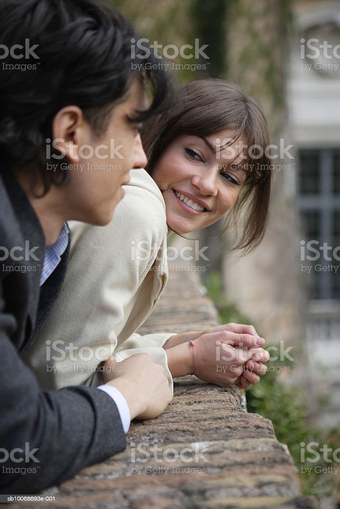 Italy, Rome, couple leaning on surrounding wall royalty-free stock photo