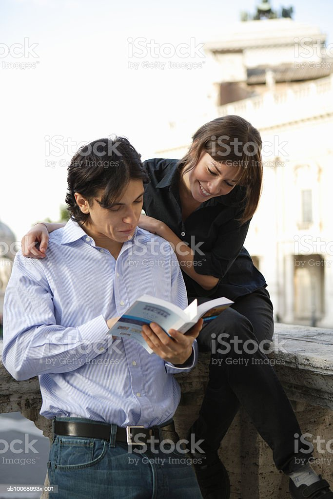 Italy, Rome, couple reading guidebook royalty-free 스톡 사진