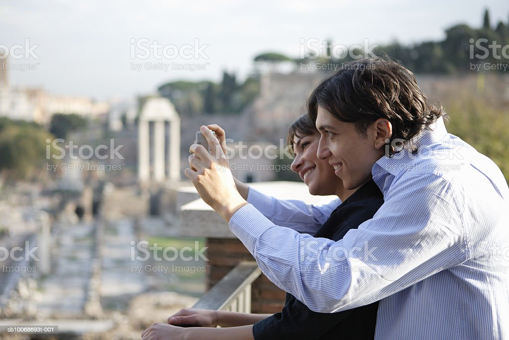 Italy, Rome, Foro Romano, couple taking photograph foto stock royalty-free