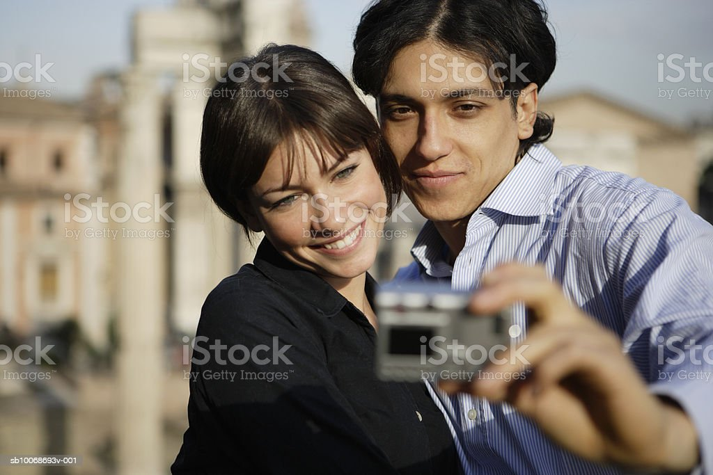 Italy, Rome, Foro Romano, couple taking photograph foto de stock libre de derechos