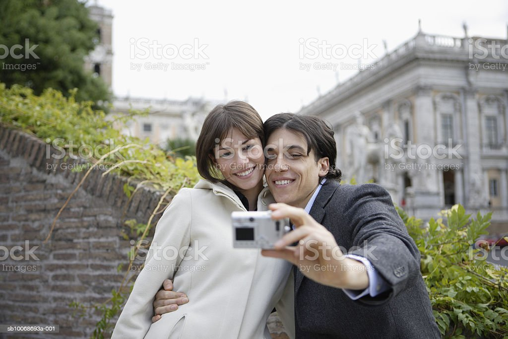 Italy, Rome, Piazza del Campidoglio, couple taking self-portrait photograph royalty-free 스톡 사진