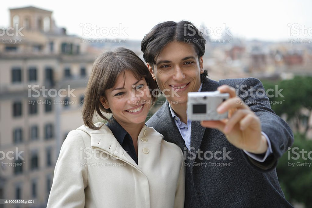 Italy, Rome, Piazza del Campidoglio, couple taking self-portrait photograph photo libre de droits