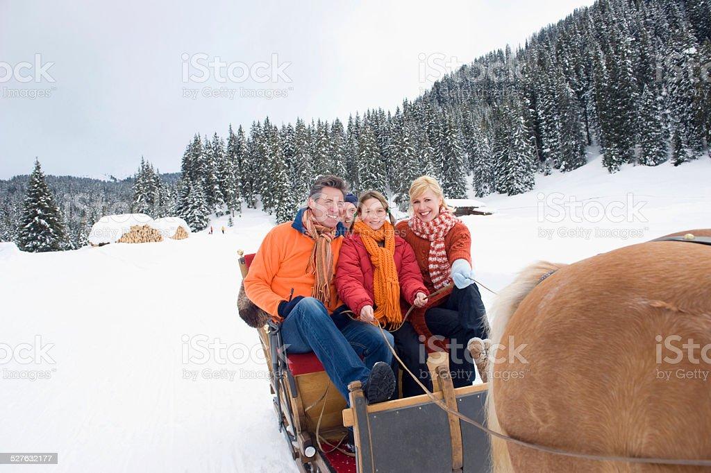 Italy, South Tyrol, Seiseralm, Family riding in sleigh stock photo