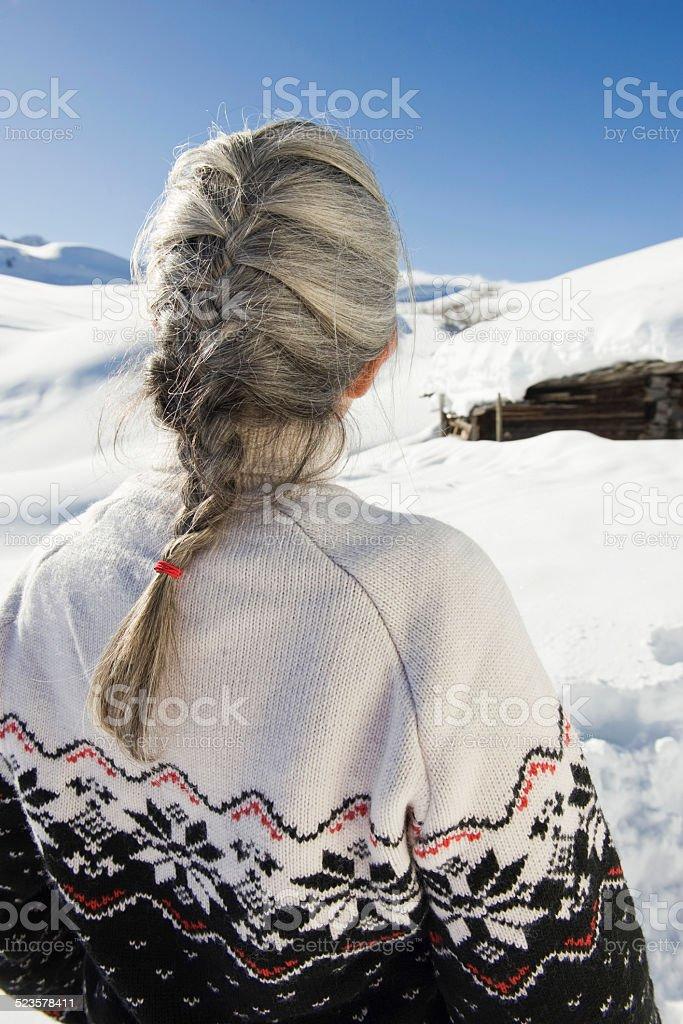 Italy, South Tyrol, Seiseralm, Senior woman, rear view stock photo