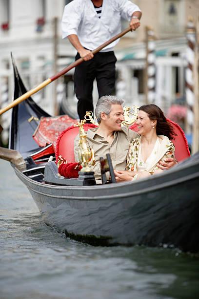 Italy, Venice, couple in gondola, smiling stock photo