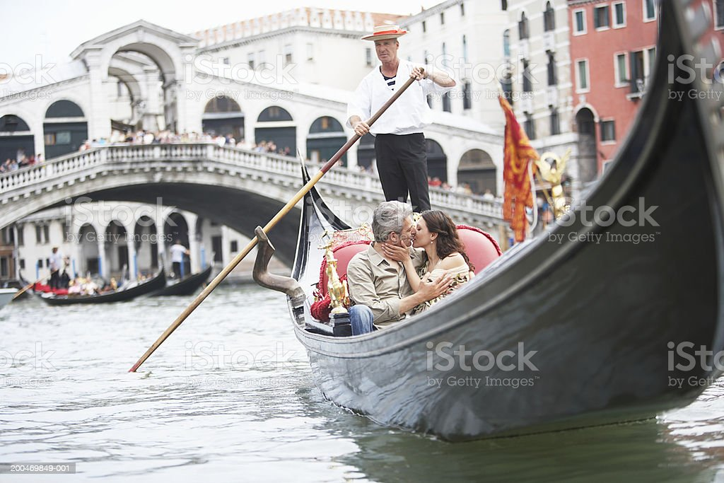 Italy, Venice, couple riding gondola, kissing stock photo