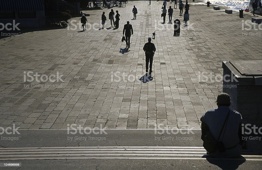 Italy, Venice, People in street casting shadows on pavement royalty-free stock photo