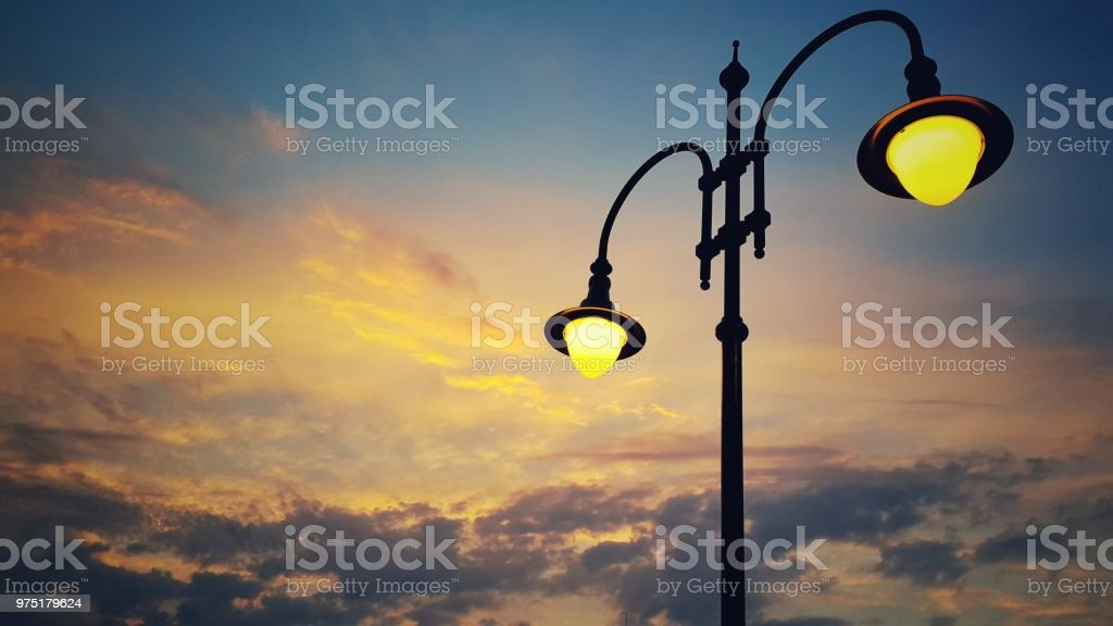 Italy Venice sunrise view, outdoor city lamp against sky and clouds