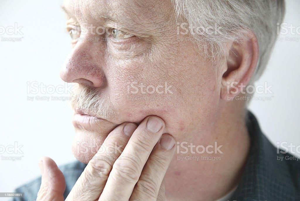 itchy rash on man's face stock photo