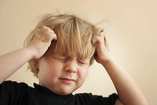 Itchy Scalp from Head Lice stock photo