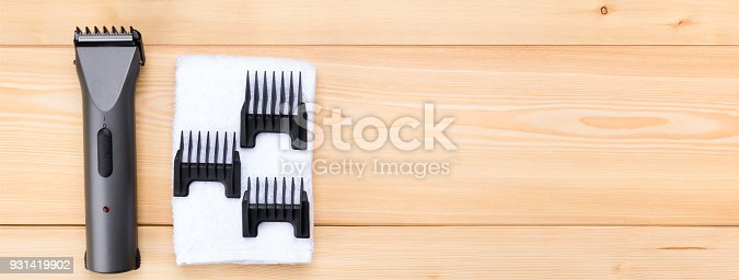 1147090180istockphoto items for a short hair clip, on a wooden background, and a white towel 931419902