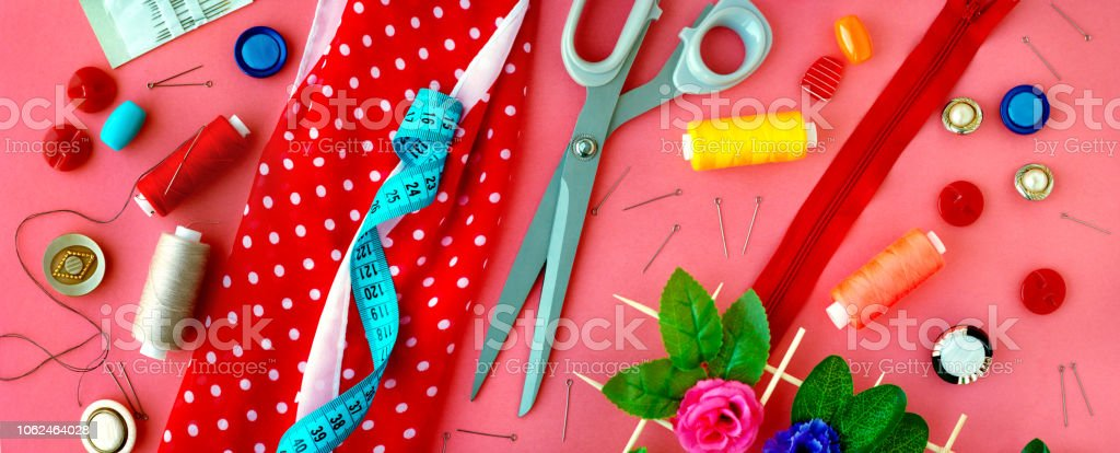 Sewing clothes. Measuring tape, tailoring scissors, threads, buttons,...