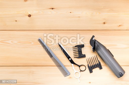 1147090180istockphoto items for short hair cutting, on a wooden background 931422026