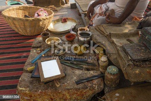 Varinasi, India, December 3rd, 2017: Items Hindu Brahman uses for ritual preparation of pilgrims in Varanasi.
