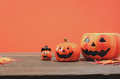 istock Items or Happy Halloween festival concept.The essential several accessory for the season.Head jack lantern and mix variety object on the modern rustic brown and the orange wallpaper background. 840412492