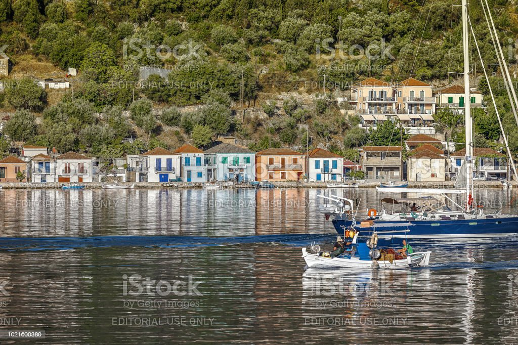 Ithaca Vathi Harbor. Greek fishermen's boat enterring the harbor. Travel Destinations. Stock Image. stock photo