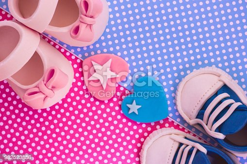 886700726istockphoto It's a boy and a girl concept. Twins background. Baby shower invitation. Retro style 982523886