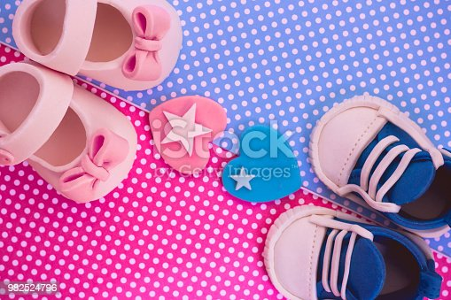886700726istockphoto It's a boy and a girl. Twins background. Baby shower invitation. Retro style 982524796