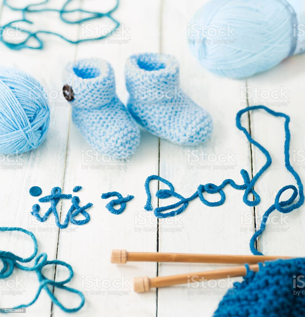 It's a Boy announcement message made from blue wool yarn stock photo