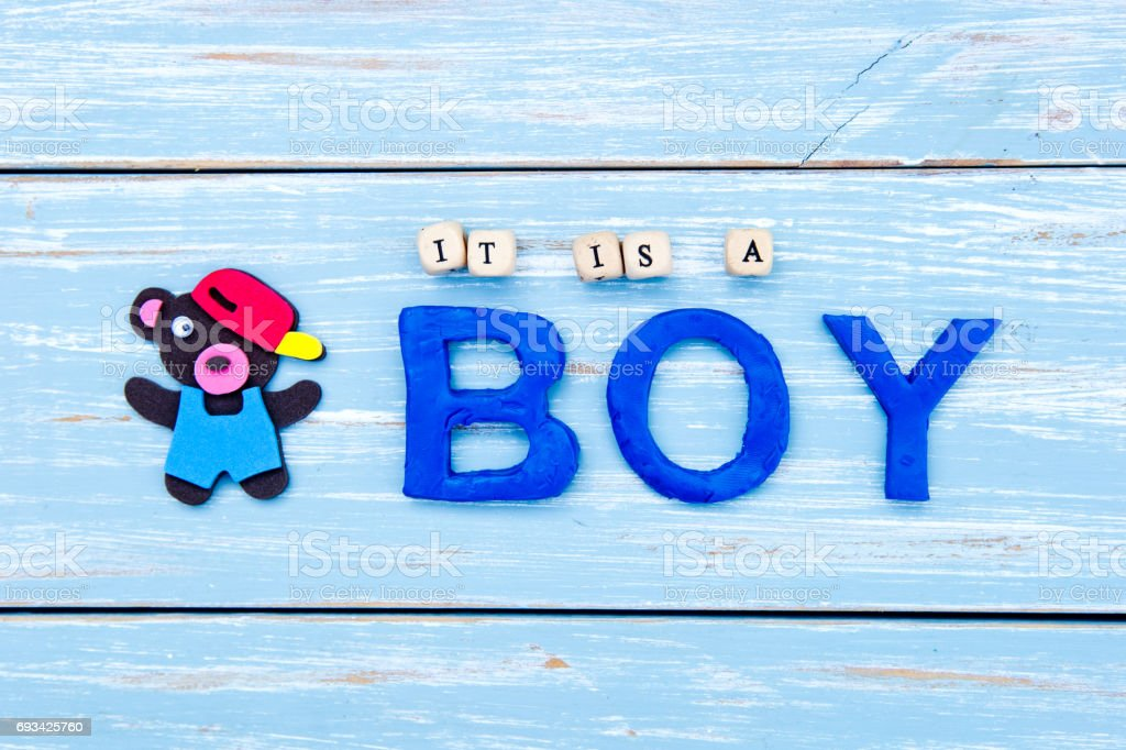 It's a Boy - on blue wooden background stock photo