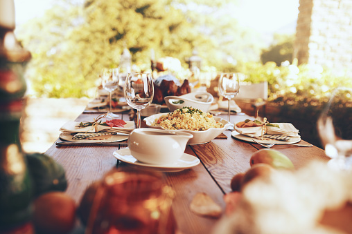 Shot of a nicely set table with all kinds of food on it for a lunch party