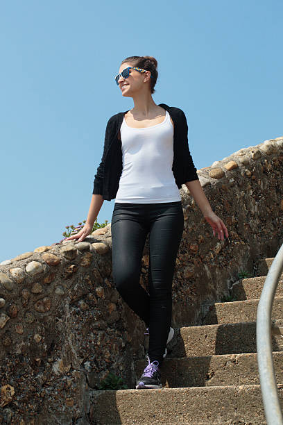 stylish russian outdoor girl walking down steps blue sky - whiteway english outdoor girl stock photos and pictures