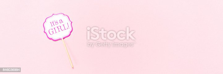 591421282 istock photo It's a girl sign at the baby shower party.  Pink solid background.  Baby shower celebration concept 846036994