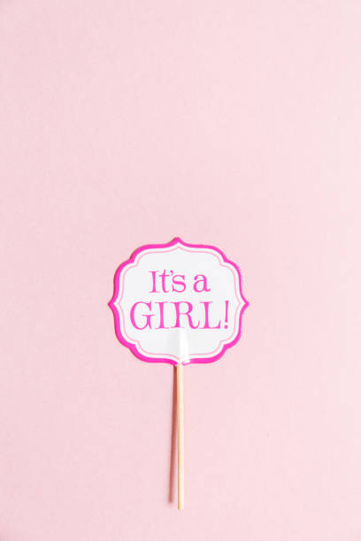 it's a girl sign at the baby shower party.  pink solid background.  baby shower celebration concept - its a girl stock photos and pictures