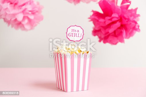 istock It's a girl sign in a popcorn bag at the baby shower party.  Baby shower celebration concept 808369318