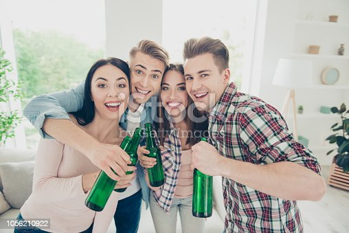 istock It's a great company! Join us! Happy, benevolent, positive youth people in trandy, sstreet style checkered shirt hug each other and look into the camera and hold bottle of drink in hands 1056210922