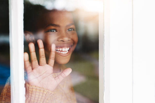 it's a great day to play outside - boy looking out window stock pictures, royalty-free photos & images