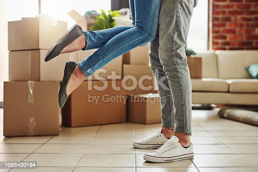 Shot of an unrecognizable couple celebrating the move into their new home