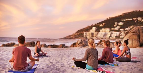 It's a perfect day for yoga at the beach