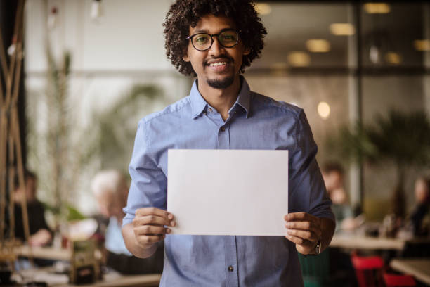 It's a space to have your say. It's a space to have your say. Business man holding empty paper. holding stock pictures, royalty-free photos & images