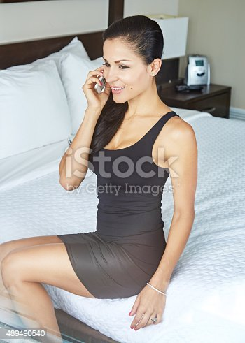 Cropped shot of a young woman using her cellphone in a hotel roomhttp://195.154.178.81/DATA/i_collage/pu/shoots/805614.jpg