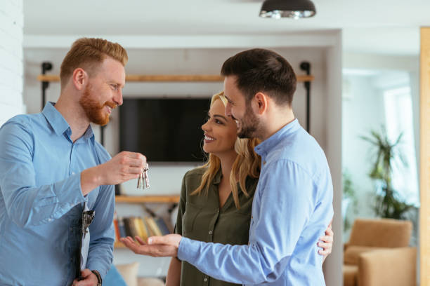 it's all yours now - estate agent stock photos and pictures