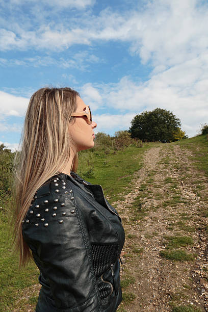 uphill path for ambitious woman profile outdoor polish girl - whiteway polish outdoor girl stock photos and pictures