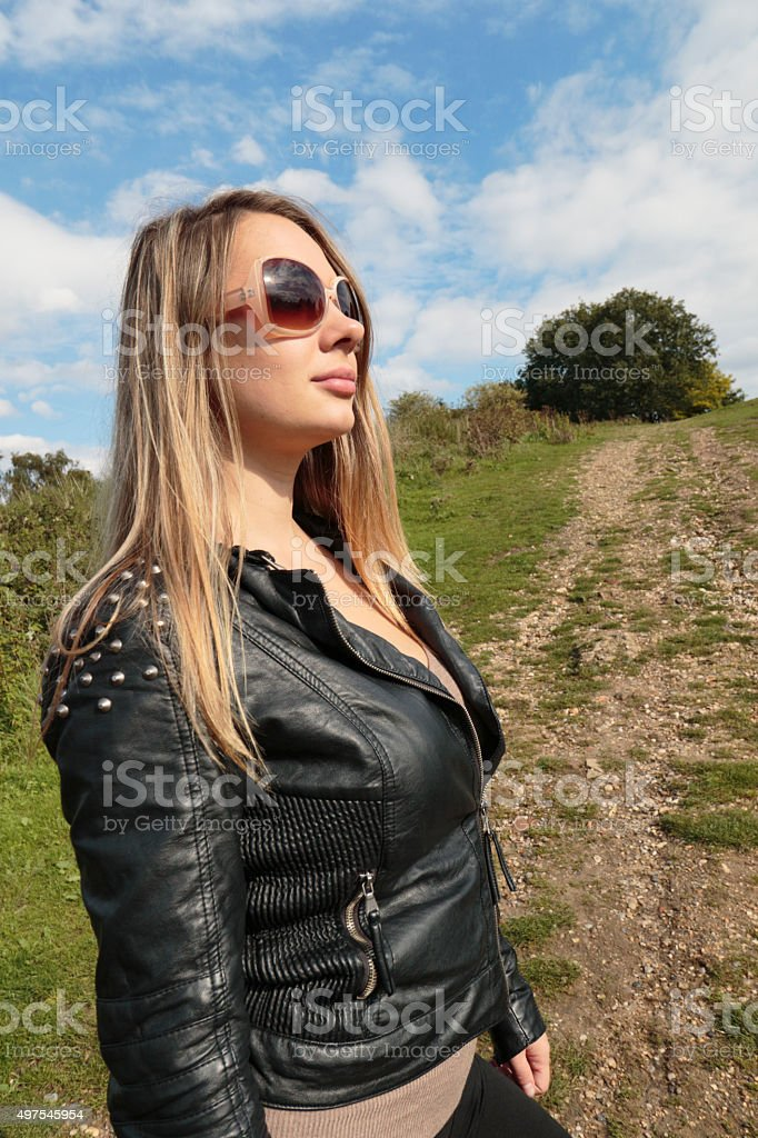 Uphill path for ambitious woman profile outdoor Polish girl stock photo