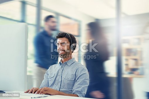 istock It's another busy and productive day in the office 658442886