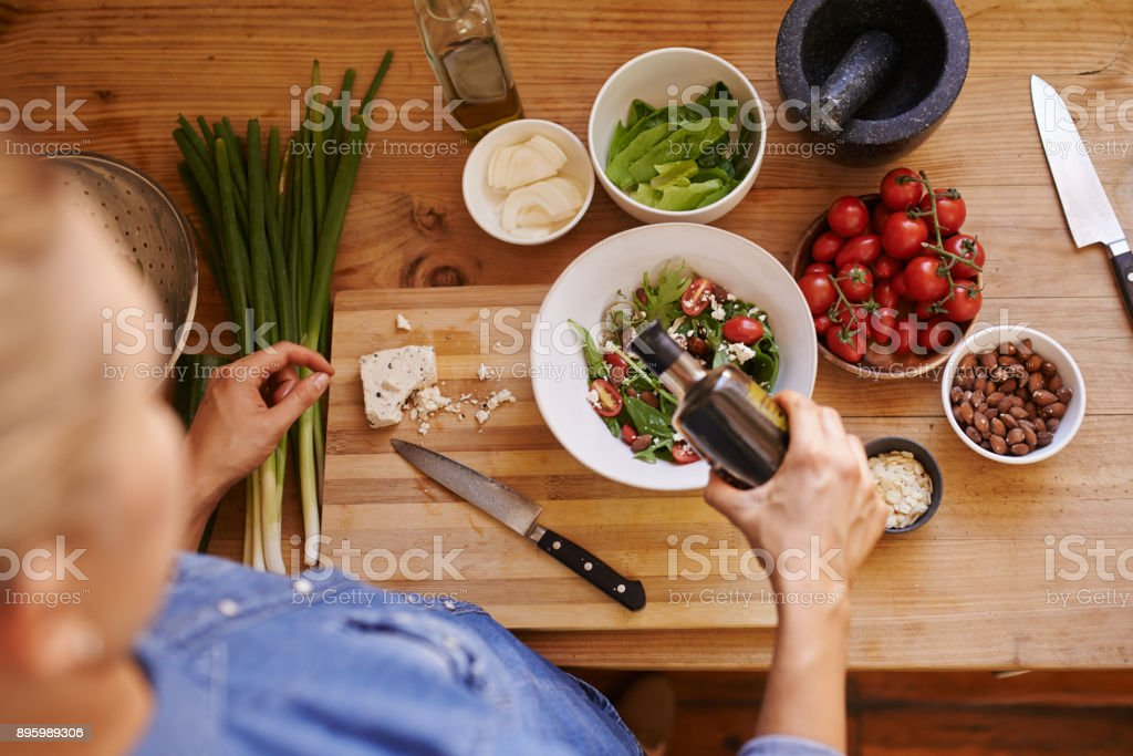 It's as easy as chop, dress, toss and serve stock photo